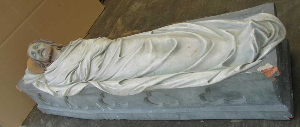 Statue Christ in tomb, crypt, casket